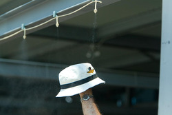 Hat soaking to fight the 89-degree heat