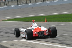 Helio Castroneves leaves the pits without his rear wing