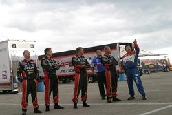 Crew members watch the sky
