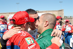 Andretti Green Racing teammates Dario Franchitti and Tony Kanaan welcome Marco Andretti to Victory lane