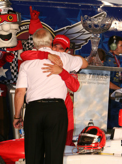 Race winner Helio Castroneves celebrates with Roger Penske