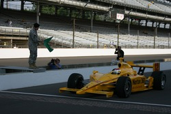 Staff Sgt. Patrick Shannon, 76th Infantry Brigade, Indiana National Guard waves the green flag on Ryan Briscoe