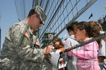 Member of the US Army signs autographs