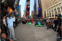 Media and fans gather around the 91st Indianapolis 500 field on Military Island in Times Square, New York