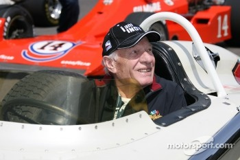 IMS Employee Bill Spoerle in A.J. Foyt's 1961 winning car as it get towed back to the Plaza area
