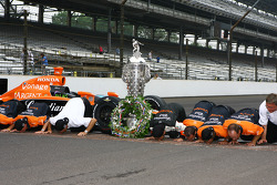 Dario Franchitti and teammates kiss the yard of bricks