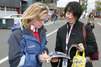 Sarah Fisher signs autographs