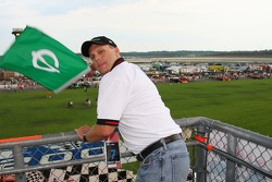 Honorary starter Patrick McKennon pratices green flag waving