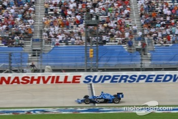 Scott Dixon takes the checkered flag