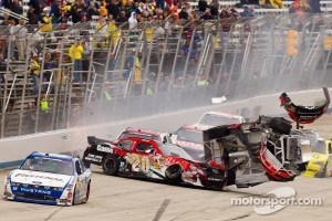 Carl Edwards races to victory while Clint Bowyer and Joey Logano have a massive crash