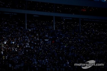 Fans light up the night