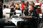 Sam Schmidt watches the clock while waiting for Alex Tagliani, Sam Schmidt Motorsports to make him final qualifying run.