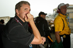 Eddie Cheever watches the action while the rain falls heavily