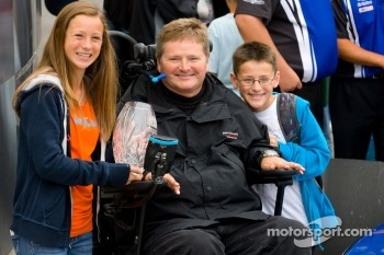 Victory lane: Sam Schmidt with family