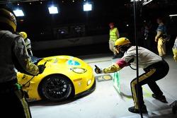 The Corvette crew services the #74