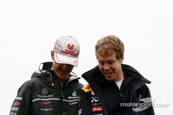 Michael Schumacher, Mercedes GP Petronas and Sebastian Vettel, Red Bull Racing