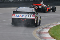 Tony Stewart in his Chevy Impala Sprint Cup car and Lewis Hamilton in his McLaren MP4-23