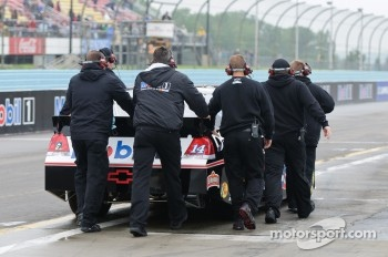 Stewart-Haas crewmen push Tony Stewart's car to the pit lane
