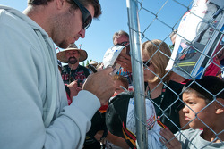 Signing autographs for fans, 56 Martin Truex Jr.,Michael Waltrip Racing  NAPA Auto Parts Toyota