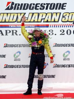 Race winner Scott Sharp celebrates