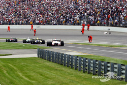 IRL safety crew picks up debris left from Dan Wheldon's crash