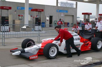 Helio Castroneves #3 goes through pre race inspection
