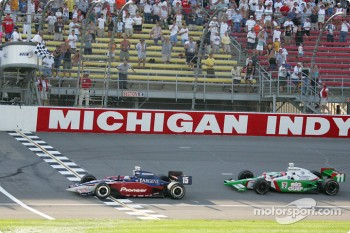 Buddy Rice takes the checkered flag ahead of Tony Kanaan