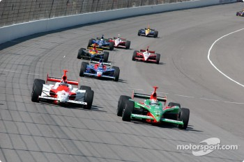 Helio Castroneves and Adrian Fernandez battle