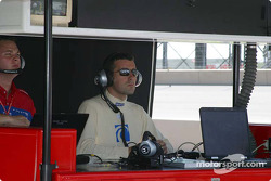 Dario Franchitti watches practice on the pit lane