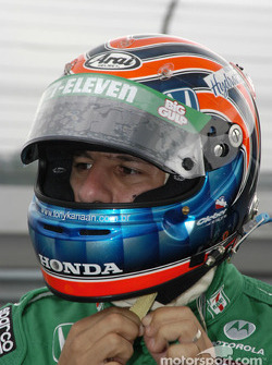 Tony Kanaan secures his helmet