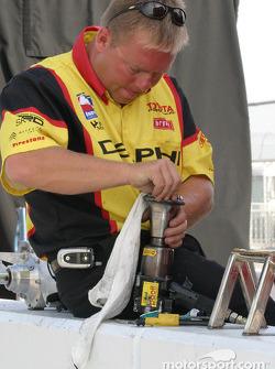 Crew member cleans up air gun