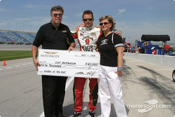 Dan Wheldon accepts a check