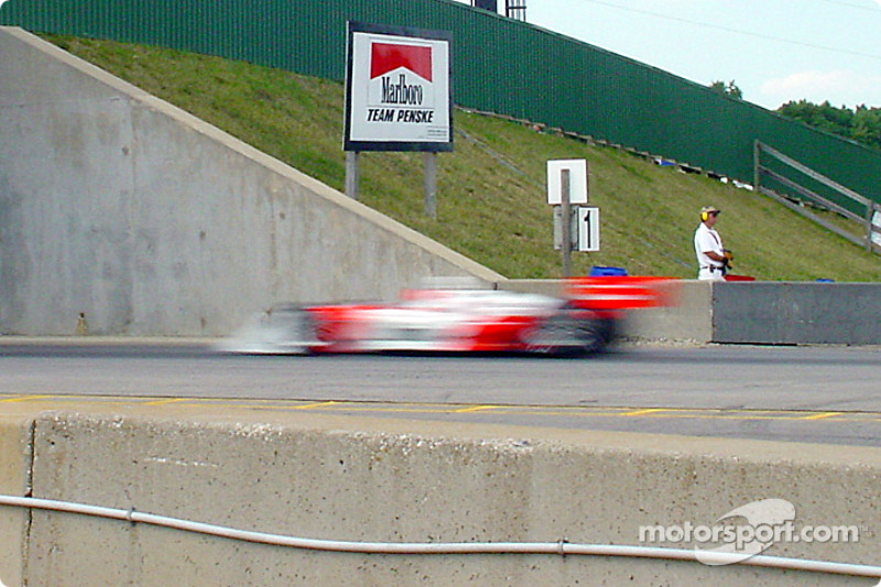 Helio Castroneves going really fast