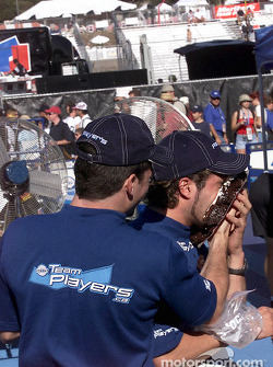 Patrick Carpentier congratulating teammate Alex Tagliani on his upcoming birthday; the sugar coated present was revenge for the same gift Patrick got for his birthday this past July from Alex