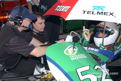 Adrian Fernandez discussing with engineers
