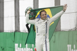 Felipe Massa, Williams, carries a Brazilian flag as he walks back to his garage in tears after crashing