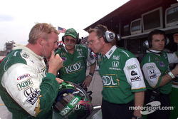 Paul Tracy discussing with engineers