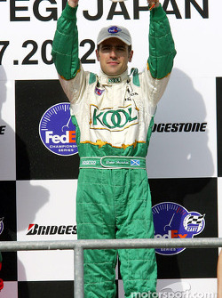 The podium: Dario Franchitti