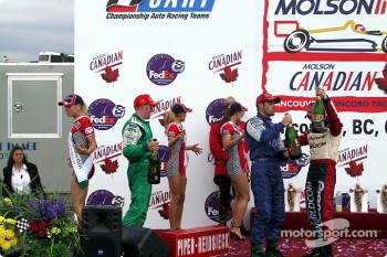 The podium: race winner Dario Franchitti with Paul Tracy and Tony Kanaan