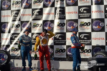 The podium: champagne for Jimmy Vasser, Patrick Carpentier and Michael Andretti