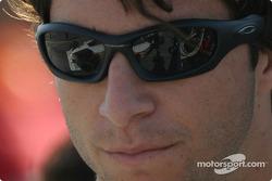 Bruno Junqueira looks at his car