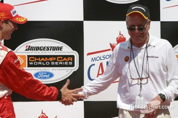 Podium: race winner Sébastien Bourdais has fun with Paul Newman