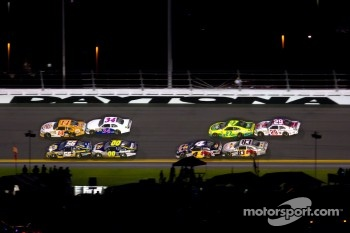 Tony Stewart, Stewart-Haas Racing Chevrolet and Martin Truex Jr., Michael Waltrip Racing Toyota lead the field