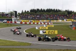 Heikki Kovalainen, Team Lotus, Timo Glock, Marussia Virgin Racing