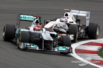 Michael Schumacher, Mercedes GP F1 Team, Kamui Kobayashi, Sauber F1 Team