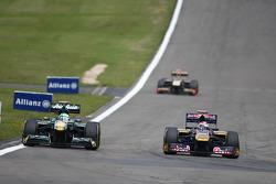 Heikki Kovalainen, Team Lotus and Sebastien Buemi, Scuderia Toro Rosso