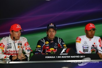 Jenson Button, McLaren Mercedes with Sebastian Vettel, Red Bull Racing and Lewis Hamilton, McLaren Mercedes