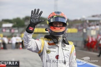 Romain Grosjean celebrates his fifth feature race win of the season