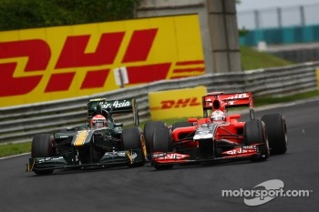 Jarno Trulli, Team Lotus and Timo Glock, Marussia Virgin Racing