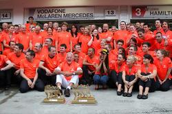 John Button Father of Jenson, Nicholas Hamilton, Brother of Lewis Hamilton, McLaren Mercedes, Lewis Hamilton, McLaren Mercedes, Jessica Michibata girlfriend of Jenson Button celebrate with the team